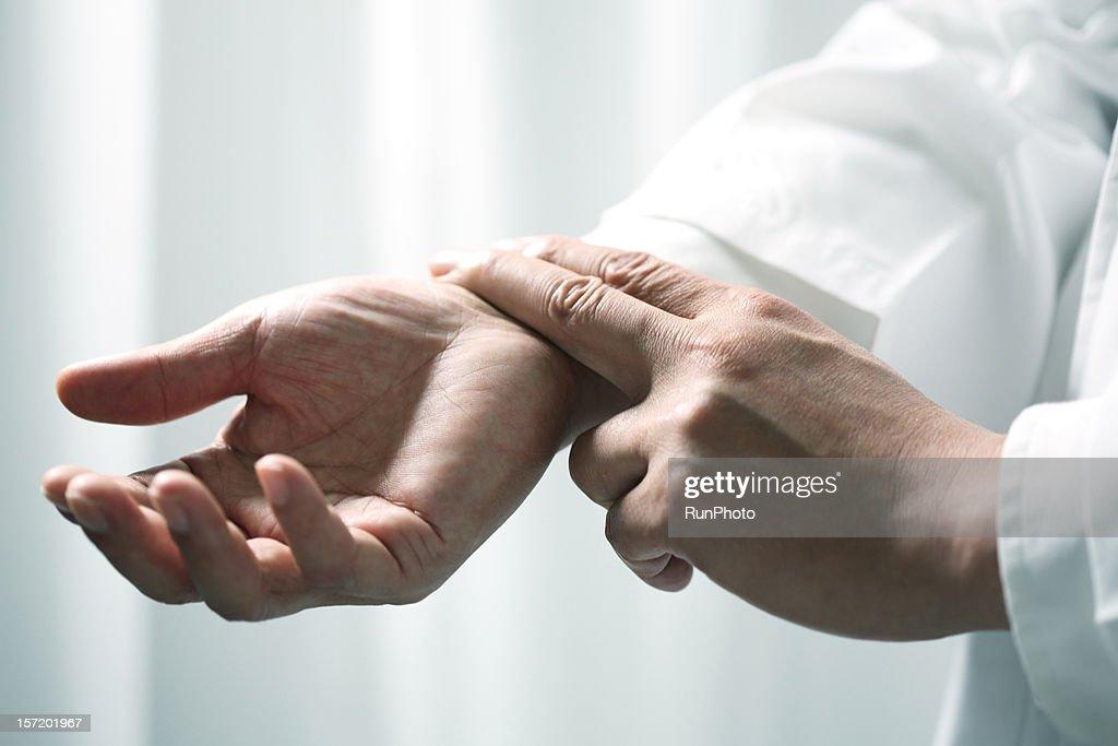 Man checking pulse, close-up