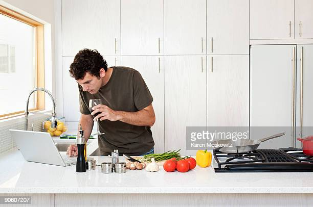 man checking recipe on computer