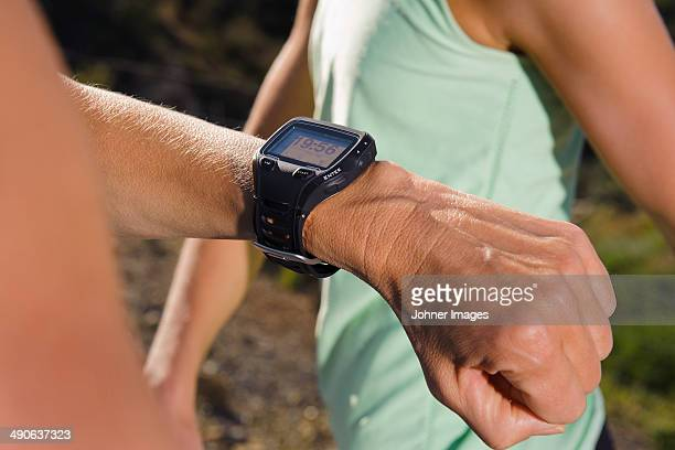 Man checking time and pulse during running, close-up