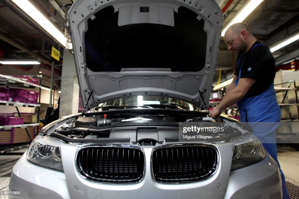 A man checks a car on the BMW 3-series production line at the BMW factory on March 15, 2010 in Munich, Germany. The German car maker will present the company's business report for 2009 on Wednesday.