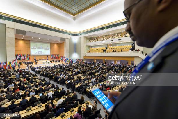 A man checks his cell phone on the opening day of the 106th International Labour Organization annual conference on June 5 2017 at the United Nations...