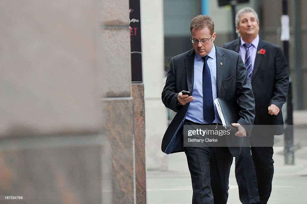 A man checks his mobile phone on the day that Twitter announced its initial public offering and debut on the New York Stock Exchange on November 7, 2013 in London, England. Twitter went public on the NYSE opening at USD 26 per share, valuing the company's worth at an estimated USD 18 billion.