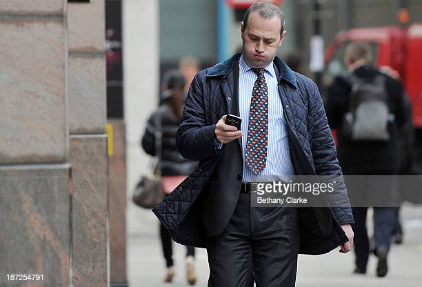 A man checks his mobile phone on the day that Twitter announced its initial public offering and debut on the New York Stock Exchange on November 7...