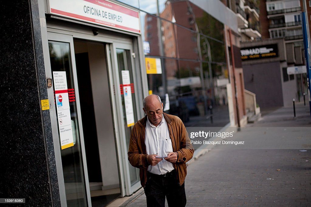 A man checks his unemployment signing slip after leaving an employment office on October 11, 2012 in Madrid, Spain. Ratings agency Standard & Poor's has cut Spain's credit rating down to BBB-. Ratings agency Standard & Poor's has cut Spain's credit rating from BBB+ down to BBB-. The Spanish government has already introduced spending cuts and tax rises in an attempt to ease their debt and reduce their high unemployment levels. Spanish Economy Minister Luis de Guindos maintains that his country will not need to ask for a bailout.