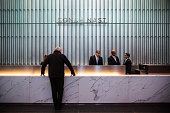A man checks in to the front desk at One World Trade Center which opens today on November 3 2014 in New York City The skyscraper is 104 stories tall...