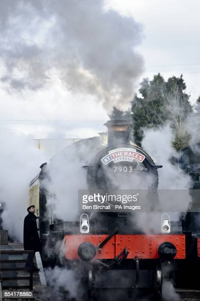 A man checks out the footplate on locomotive GWR Prairie Class number 5542 as it waits at Toddington station taking Cheltenham racegoers to the...