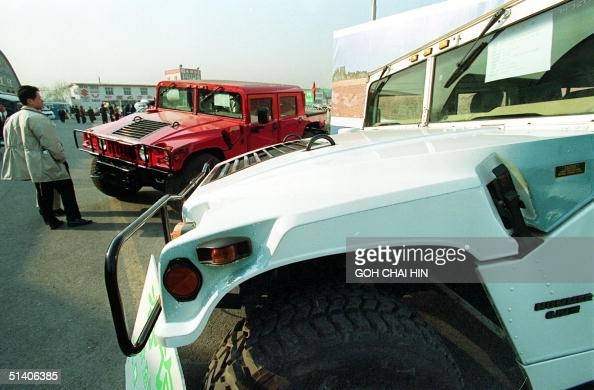 A man checks out the latest wheels to hit the Chinese roads the Hummer a modified version of the US military allterrainvehicle at a local car show in...