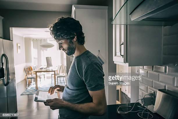 Man checks tablet