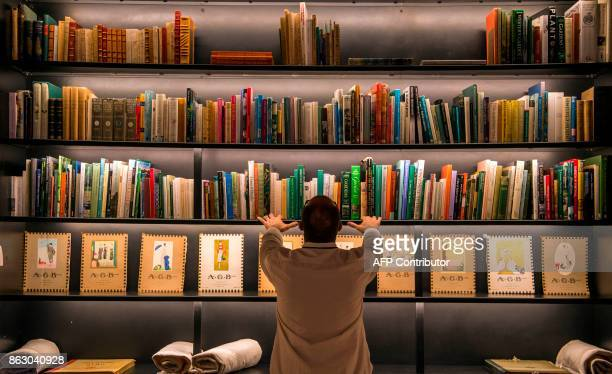 A man checks the books at the new Yves Saint Laurent museum in the Moroccan city of Marrakesh on October 19 2017 A fusion of the Moroccan traditions...