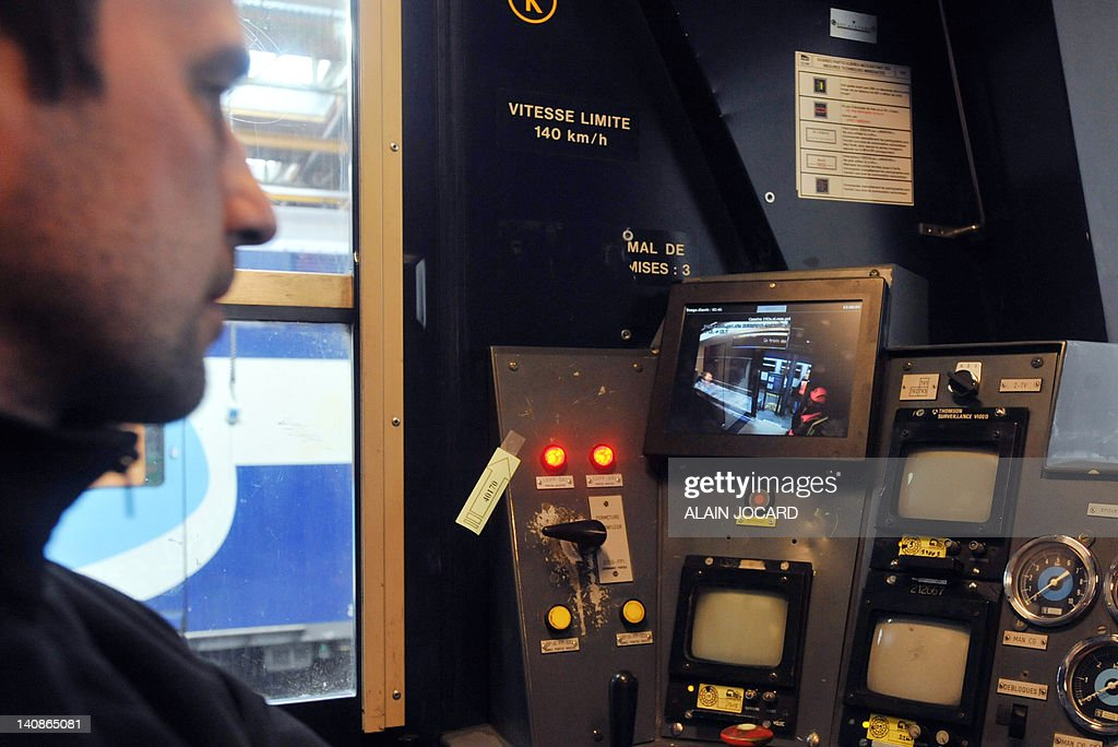 A man checks the new video surveillance system that will be install in all double-decker trains RER (Regional Express Network) serving Paris and its suburbs, on March 7, 2012 in Saint-Pierre-des-Corps, central France, during the renovation of RER trains.