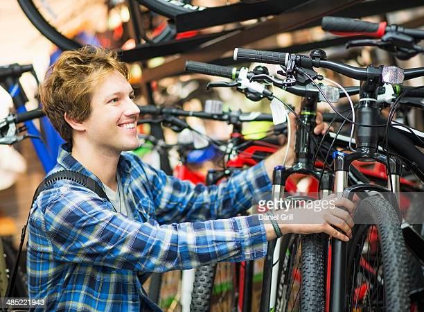 Man choosing bike in bike shop