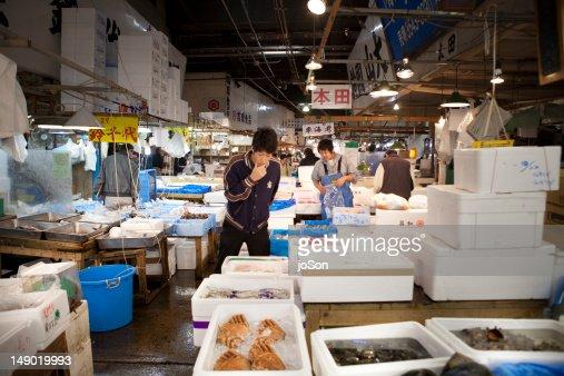 Man choosing fish at Tsukiji Market