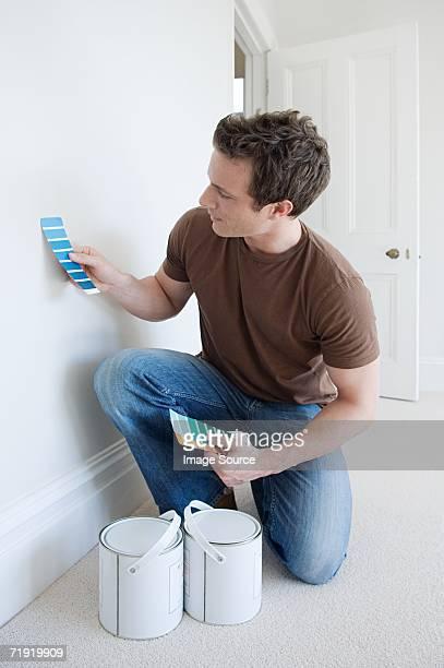 Man choosing paint colours