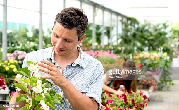 Man Choosing Plant in a Flower Shop