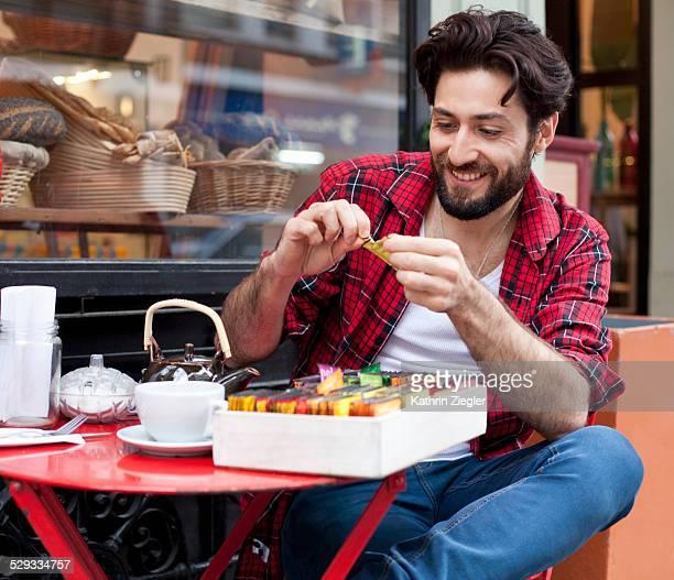 man choosing tea bag from selection