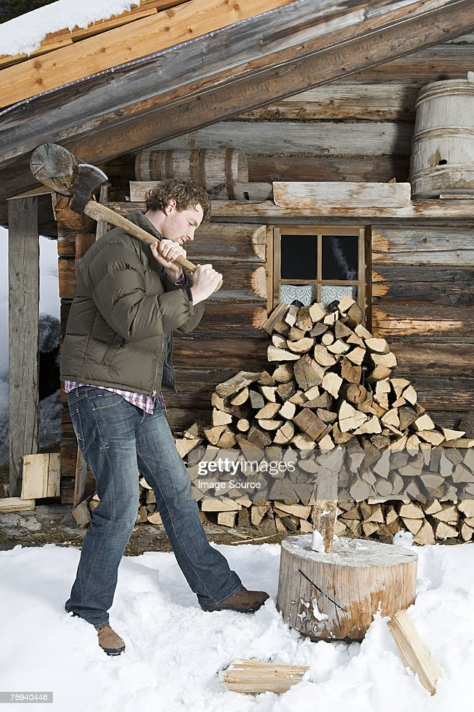 Man chopping logs : Stock Photo