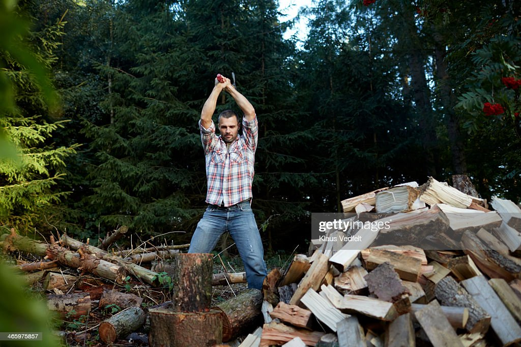 Man chopping wood with axe : Stock Photo