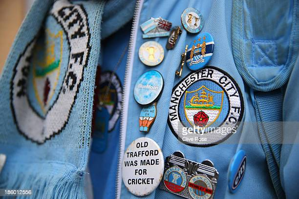 Man City supporter shows off his pin badges ahead of the Barclays Premier League match between Chelsea and Manchester City at Stamford Bridge on...