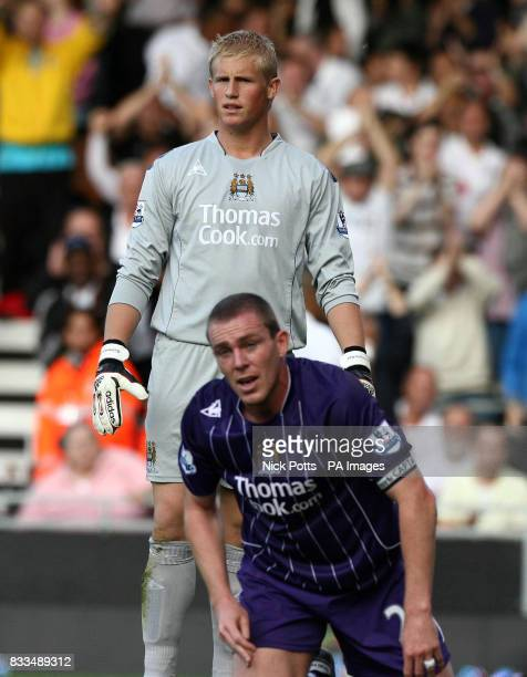 Man City's Kasper Schmeichel and Richard dunne dejected after Fulham's third goal during the Barclays Premier League match at Craven Cottage west...