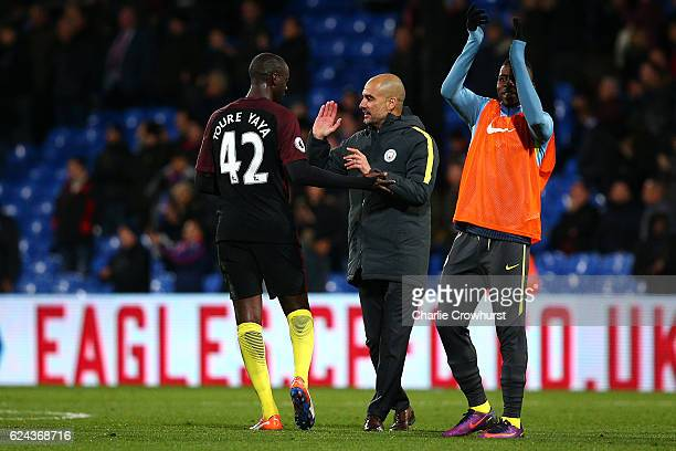 Man City's Manager Pep Guardiola celebrates the teams win with Yaya Toure after the whistle during the Premier League match between Crystal Palace...