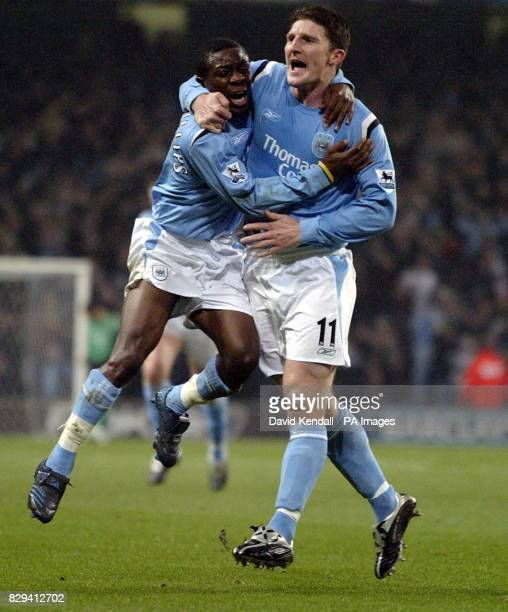 Man City's Shaun Wright Phillips helps Jon Macken celebrate his goal against Aston Villa during the Barclays Premiership match at The City of...