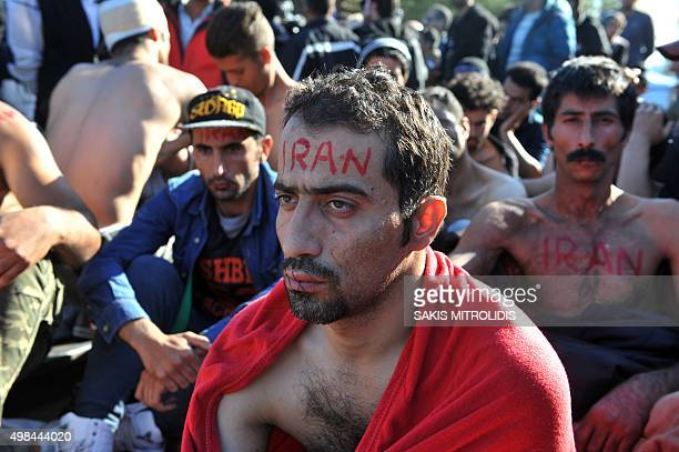 A man claiming to be from Iran with his mouth sewn shut takes part in a demonstration with fellow migrants and refugees as they wait to cross the...