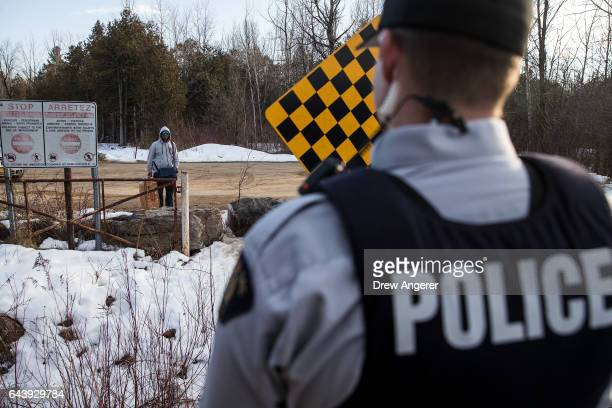 A man claiming to be from Sudan is confronted by a Royal Canadian Mounted Police officer as he prepares to cross the USCanada border into Canada...