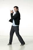 Man clapping hands, posing in studio