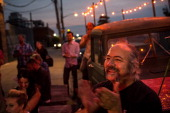 A man claps during the reopening ceremony for Sunny's Bar a landmark bar that has been open for over a century on August 29 2013 in the Red Hook...