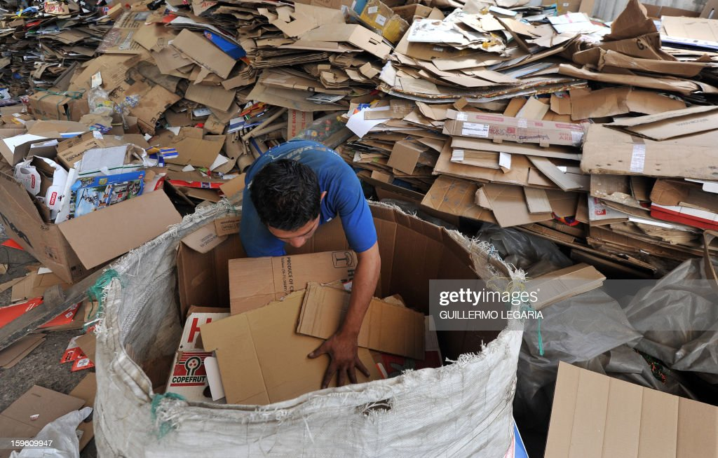 A man classifies garbage at La Alqueria Recycling Center in Bogota, Colombia, on January 17, 2013. Some 60 recyclers classify 10 tons daily of potentially recyclable waste at this recycling center wich is part of Bogota's Mayor program 'Basura Cero' (Zero waste). AFP PHOTO/Guillermo LEGARIA