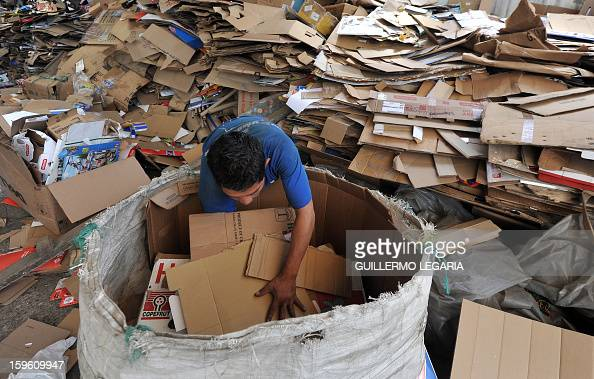 A man classifies garbage at La Alqueria Recycling Center in Bogota Colombia on January 17 2013 Some 60 recyclers classify 10 tons daily of...
