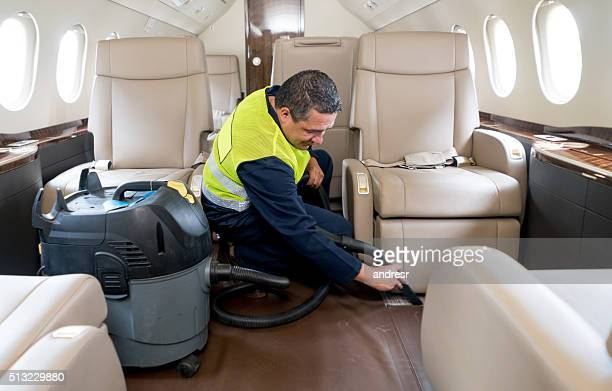 Man cleaning a private airplane