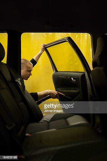 Man cleaning car door in carwash