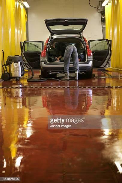 Man cleaning car in carwash