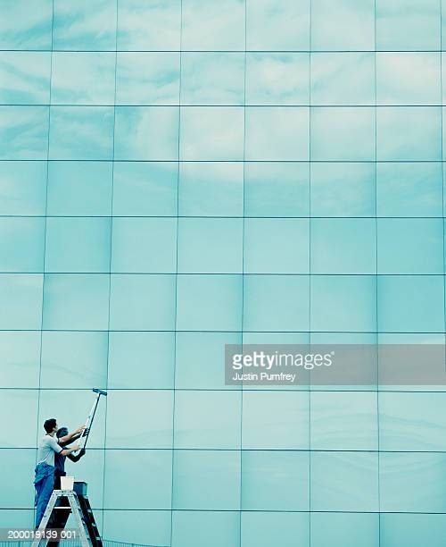 Man cleaning office windows