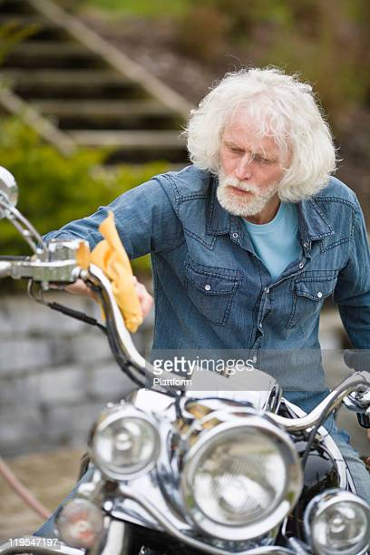 Man cleaning vintage motorbike