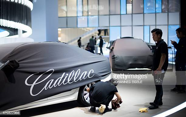 A man cleans a Cadillac ahead of the 16th Shanghai International Automobile Industry Exhibition in Shanghai on April 19 2015 China is crucial to...