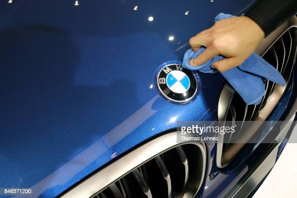 A man cleans at BMW X3 car at the 2017 Frankfurt Auto Show 'Internationale Automobil Ausstellung' on September 13 2017 in Frankfurt am Main Germany...