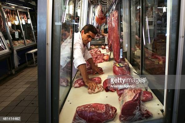 A man cleans meat shelf in Athens Greece on July 20 2015 Many goods and services become more expensive on Monday as a result of a rise in Value Added...