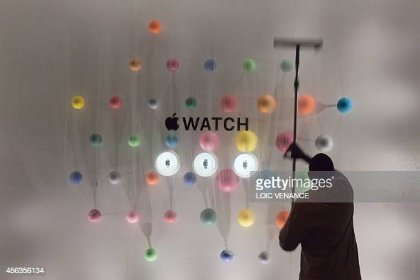 A man cleans the window displaying the Apple watch during the unveiling of the new and highly anticipated product at SaintHonore street in Paris on...