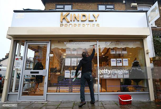 A man cleans the windows of an estate agents on December 4 2014 in in East Dulwich London England In his autumn statement Chancellor of the Exchequer...