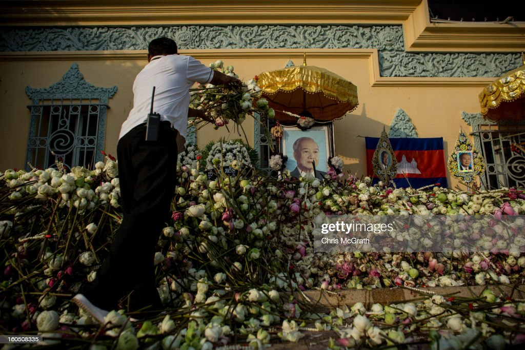 A man cleans up thousands of flowers layed at the Royal Palace for former King Norodom Sihanouk on February 2, 2013 in Phnom Penh, Cambodia. The former kings coffin was transported to the cremation site yesterday after being paraded through the capital in a lavish funeral procession. The cremation will take place on Monday the 4th of February, the funeral pyre will be lit by his wife and son King Norodom Sihamoni.