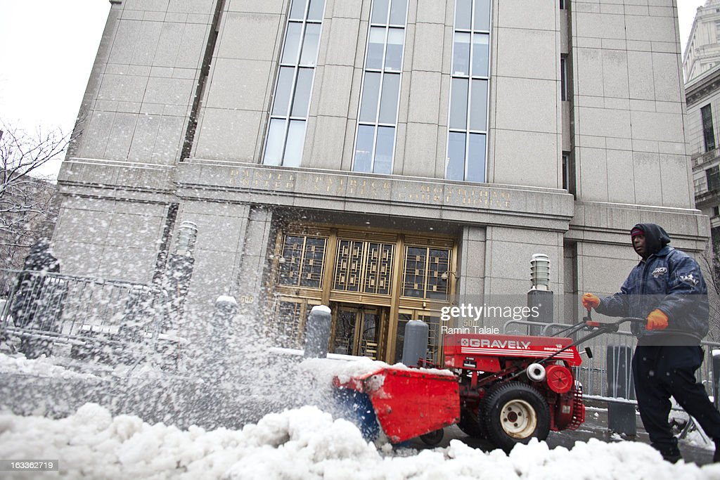 A man clears snow outside the Daniel Patrick Moynihan United States Court House where Sulaiman Abu Ghaith was arraigned on March 8, 2013 in New York City. Abu Ghaith, a son-in-law of Osama bin Laden and former associate, plead not guilty at his arraignment on charges of conspiracy to kill Americans.