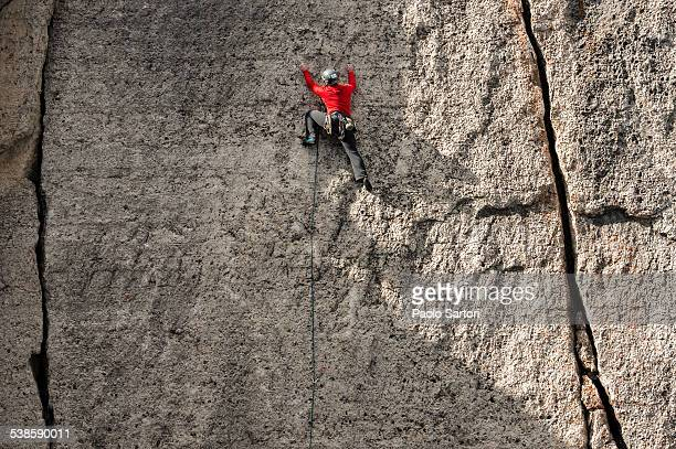 Man climbing a wall near Corbets Couloir, Jackson Hole, Wyoming.