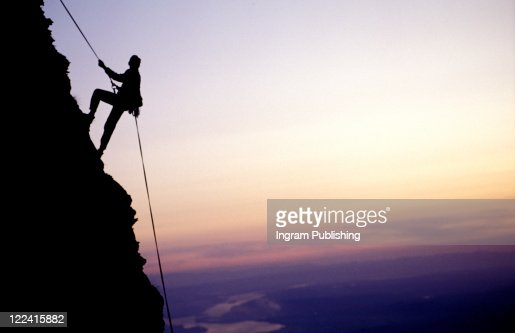 Man climbing down  : Stock Photo