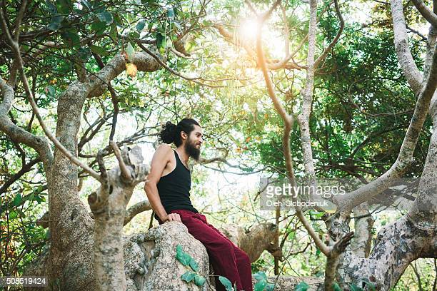 Man climbing on the tree