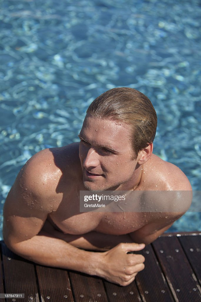 Man Climbing Out Of Swimming Pool Photo Getty Images