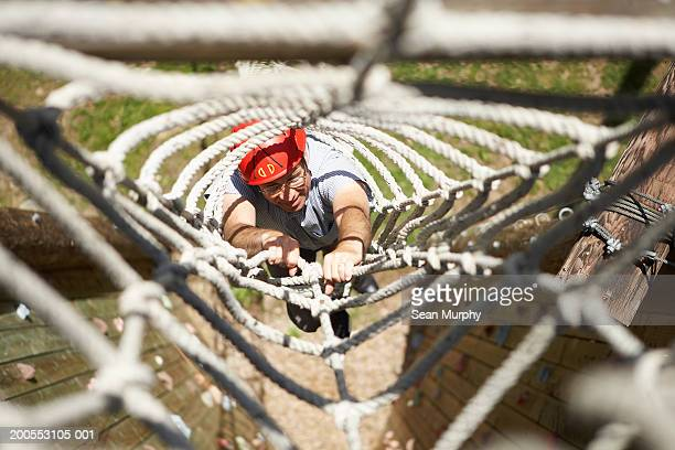 Man climbing rope obstacle