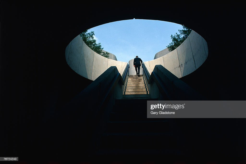 Man climbing stairs : Stock Photo