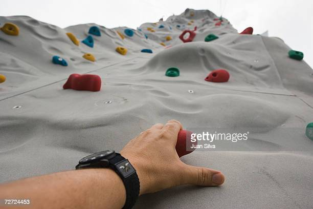 Man climbing wall, low angle view